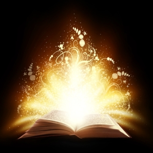Open book with sparkles and light swirling out