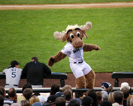 Moose mascot dancing in front of the crowd at a baseball game