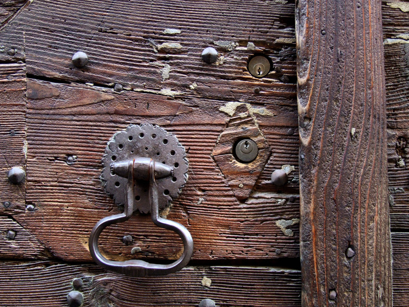Close Up Of An Old Wooden Door With A Knocker