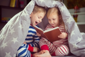 Kids laughing and reading